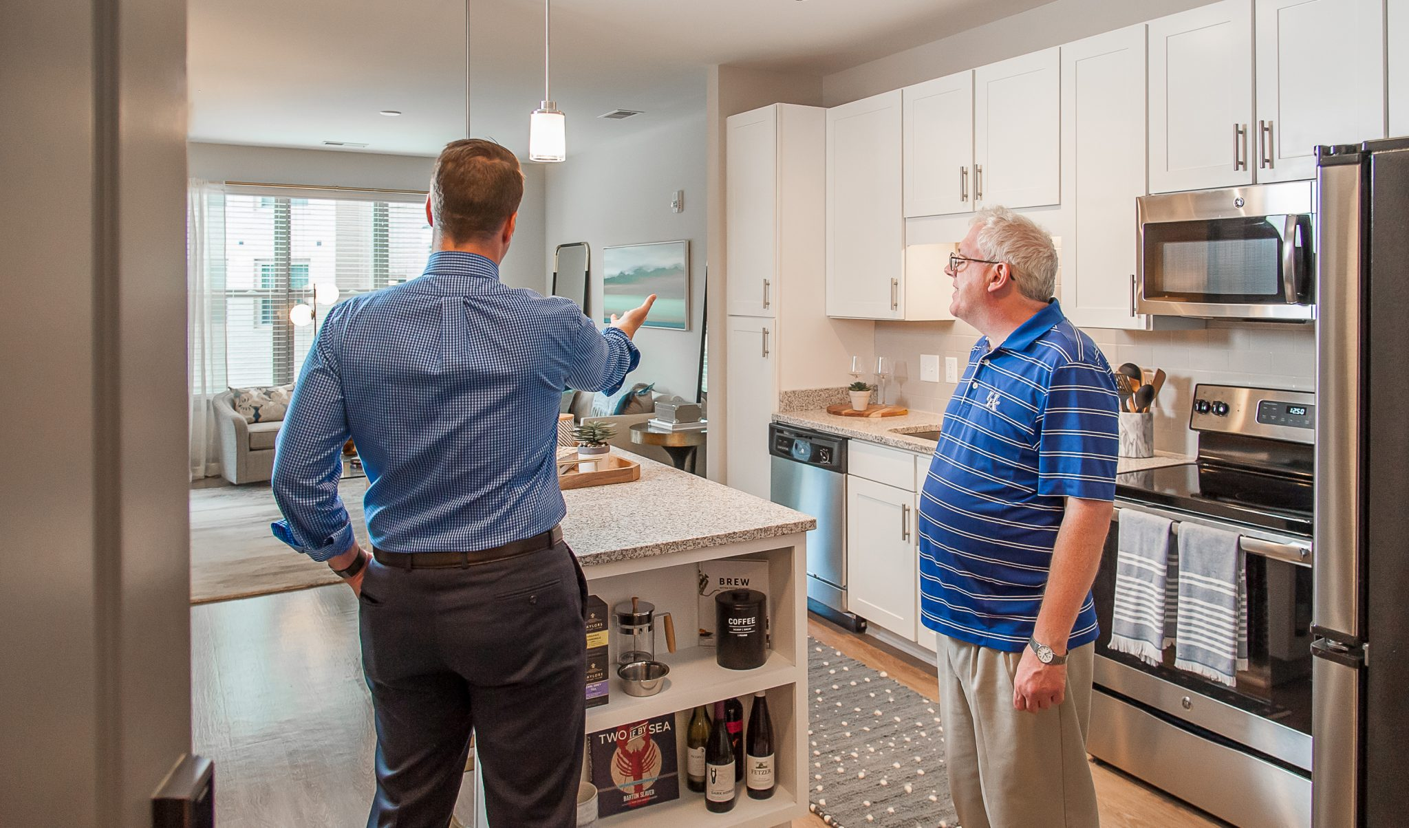 Consumer with a realtor, touring an apartment