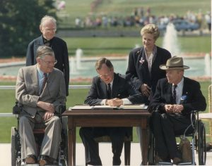 George H.W. Bush signing Americans with Disabilities Act into law